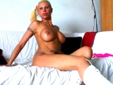 Busty blonde Runs A Strip and solo pussy show